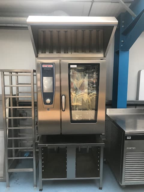 Rational Rational 10 grid combi oven with hood and stand Self Cooking Centre. Electric